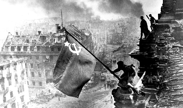 Soldier Raising The Soviet Flag Over The Reichstag