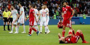 Soccer Football - World Cup - Group B - Iran vs Spain - Kazan Arena, Kazan, Russia - June 20, 2018   Iran players look dejected after the match as Spain players celebrate    REUTERS/Toru Hanai